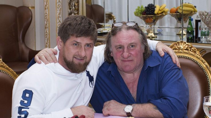 Actor Gerard Depardieu poses for a picture with Chechen President Kadyrov during a meeting at the presidential residence in Grozny