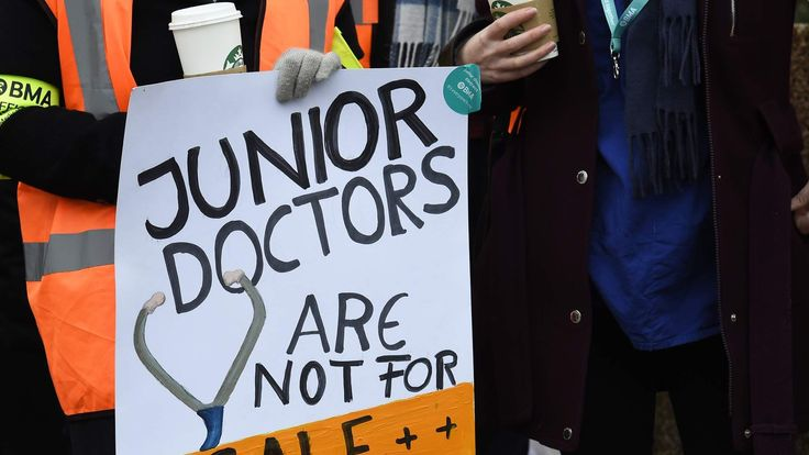"A placard that reads ""Junior Doctors Are Not For Sale"" is displayed during a strike outside St Thomas' Hospital in London"
