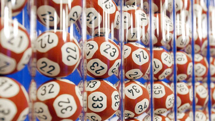 shows balls used for the EuroMillions lottery at the headquarters of Francaise des Jeux