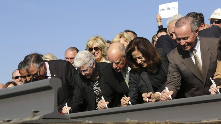 California Governor Jerry Brown and his wife, Anne Gust, sign a railroad rail during a ceremony for the California High Speed Rail in Fresno