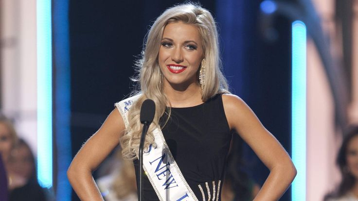 Miss America 2014 contestant, Miss New Jersey Cara McCollum stands on stage during the Miss America Pageant in Atlantic City