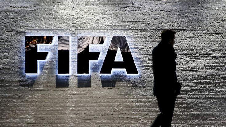 A journalist walks in front of FIFA's headquarters in Zurich