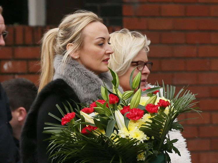 Mourners arrive with flowers at Our of Lourdes Church in Dublin