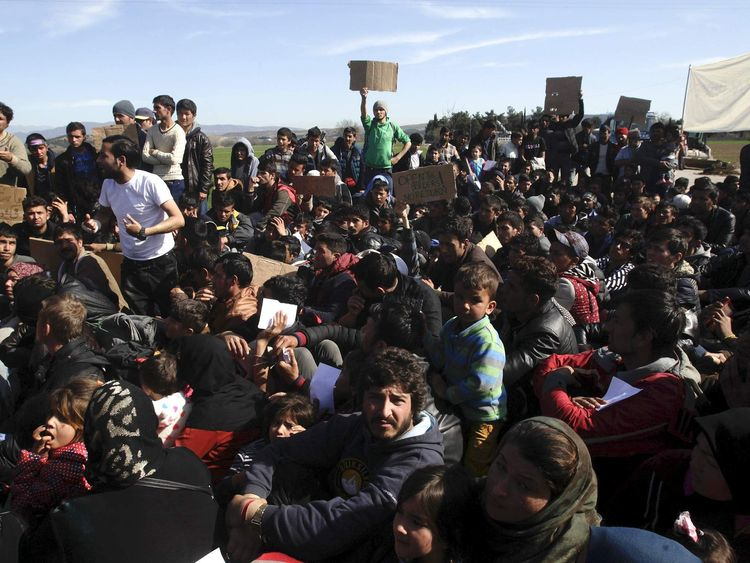 Refugees and migrants stage a protest at the Greek-Macedonian border, following a demand by Macedonia for additional identification from people seeking to cross the border and head to Western Europe, near the village of Idomeni