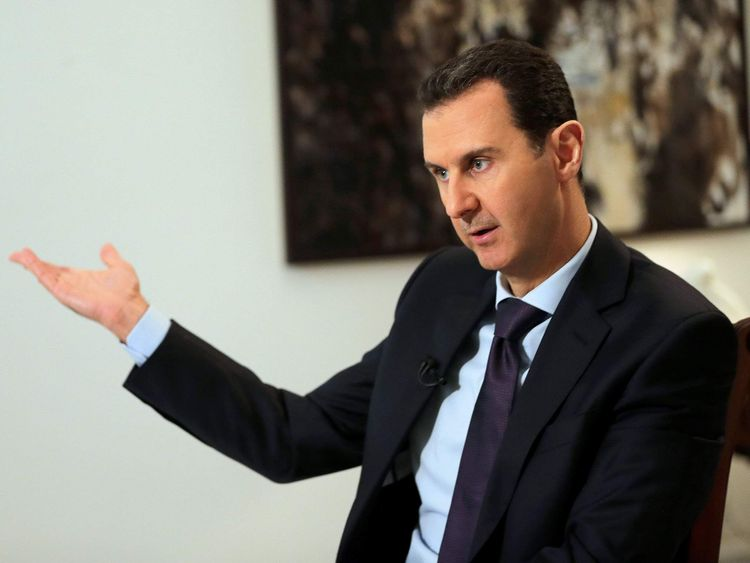 Syrian President Bashar al-Assad gestures during an exclusive interview with AFP in the capital Damascus.