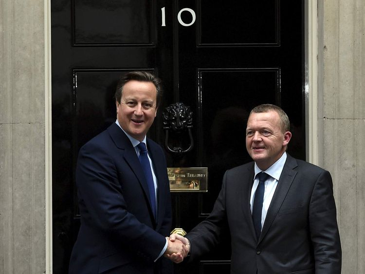 Britain's Prime Minister David Cameron greets his Danish counterpart Lars Lokke Rasmussen at the entrance of 10 Downing Street in London