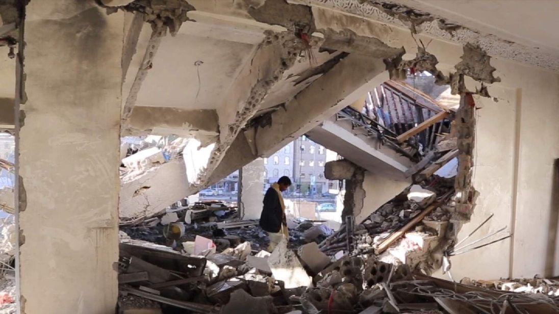 Yemen - Sadiq Rubeid inspects the ruins of his family's home