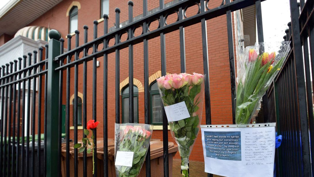 Flowers left at a mosque near the scene of a hit-and-run attack.