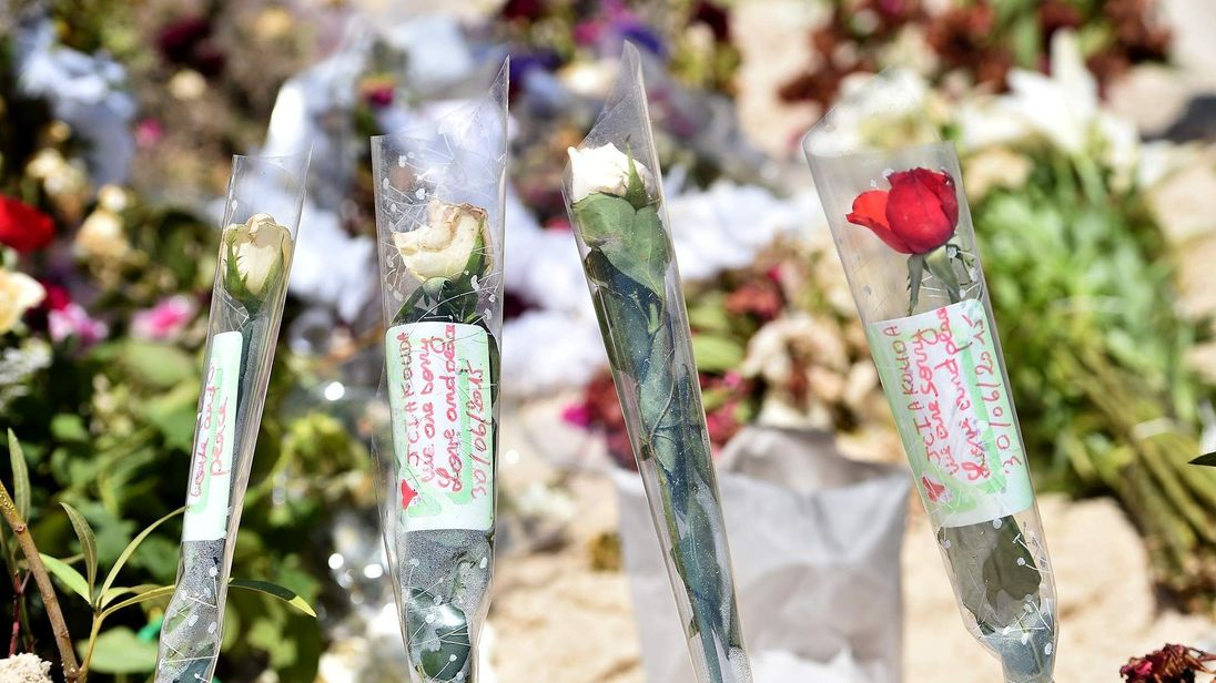 Flowers are placed on Marhaba beach, where 38 people were killed in a terrorist attack