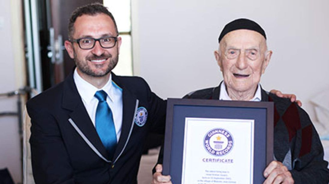 World's oldest man Israel Kristal receives his certificate from Guinness World Records head of records Marco Frigatti