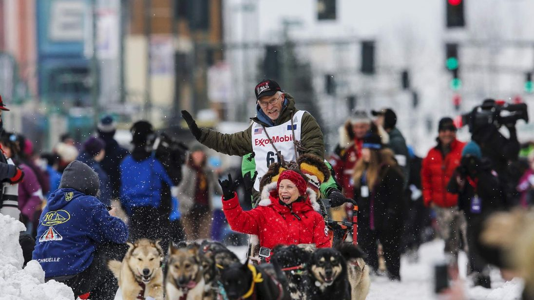 Four-time Iditarod champion Jeff King and his team start the Iditarod race