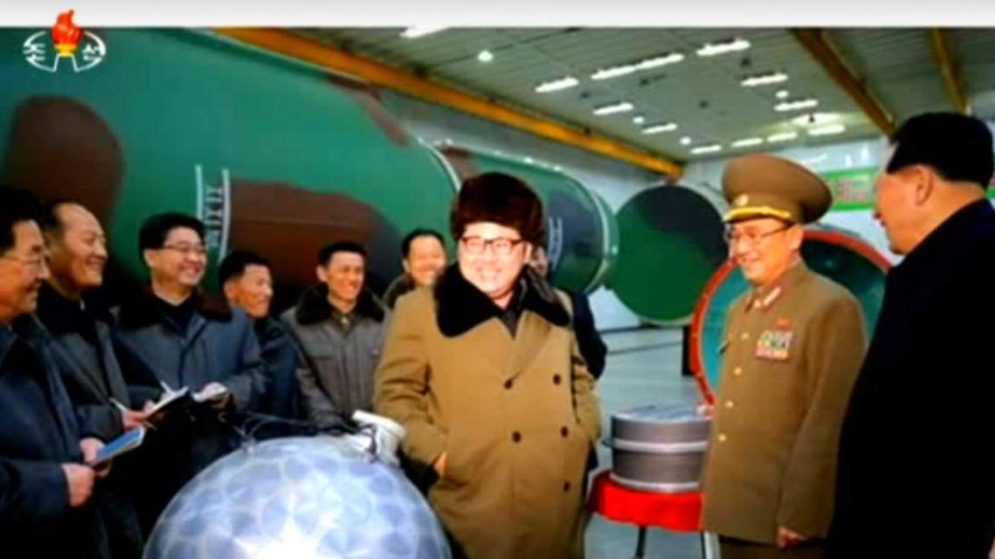 Supreme leader Kim Jong Un inspects one of his country's mini nuclear bombs