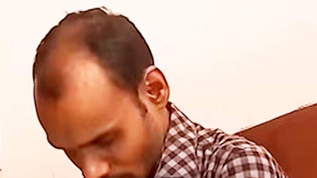 Sanil K James (C) in court
