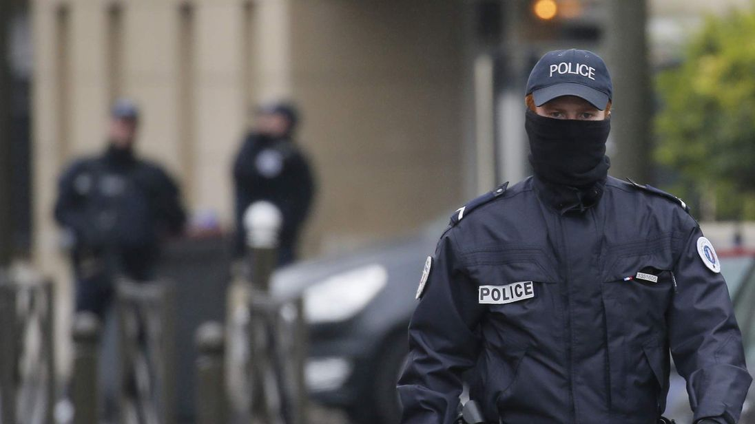French Police secure the area near an apartment building after a raid in Argenteuil, a suburb in northern Paris