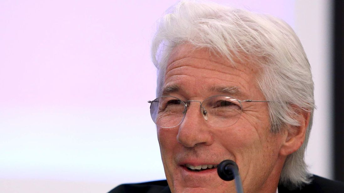 Actor, activist and philanthropist Gere participates in a House Financial Services Committee briefing on Capitol Hill in Washington