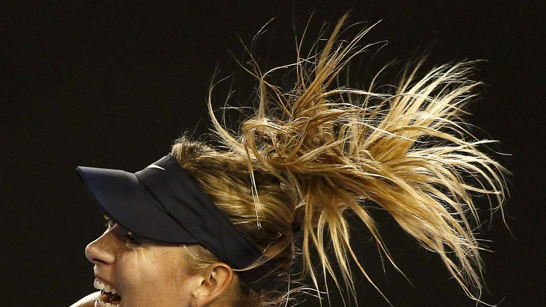 Russia's Sharapova serves during her third round match against Davis of the U.S. at the Australian Open tennis tournament at Melbourne Park