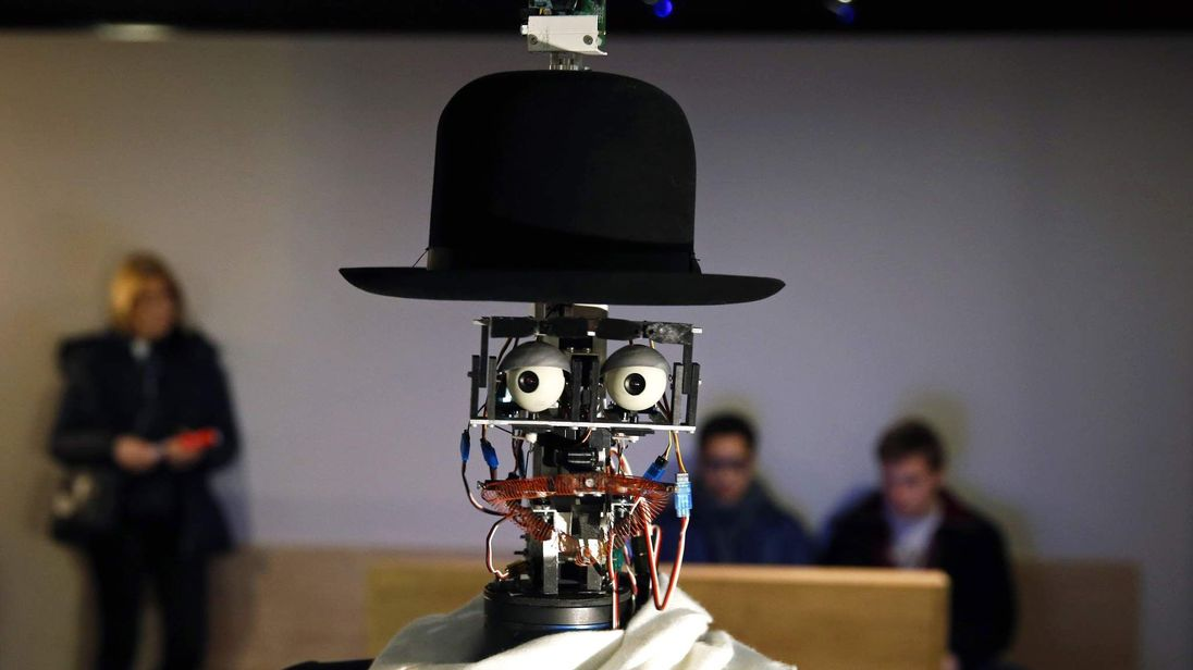 "The Berenson robot strolls among visitors during the exhibition ""Persona : Oddly Human"" at the Quai Branly museum in Paris"