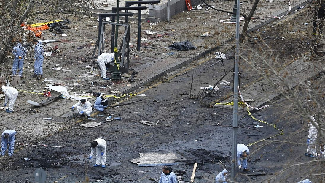 Forensic officers work on the site of a suicide bomb attack in Ankara