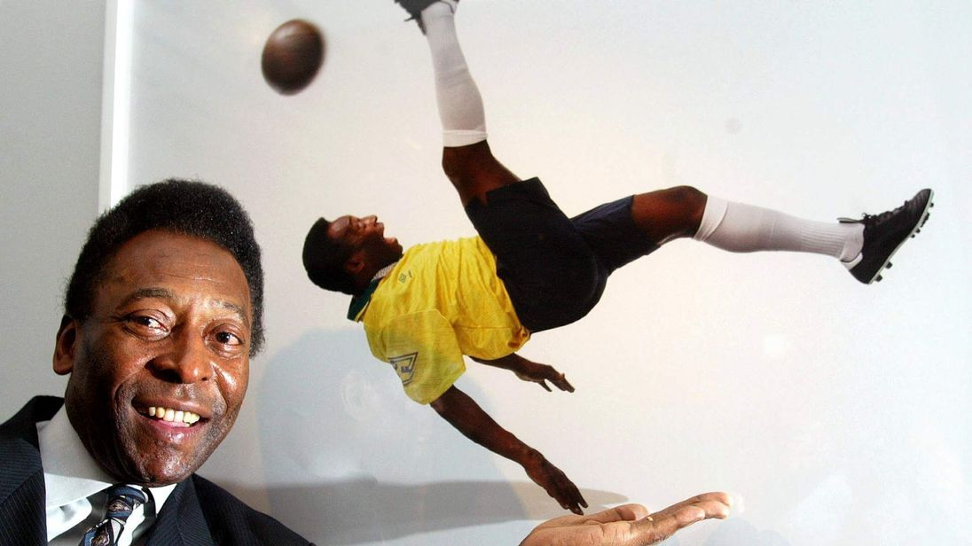 Brazil soccer legend Pele stands next to a photograph of him by Patrick Lichfield at the opening of ..