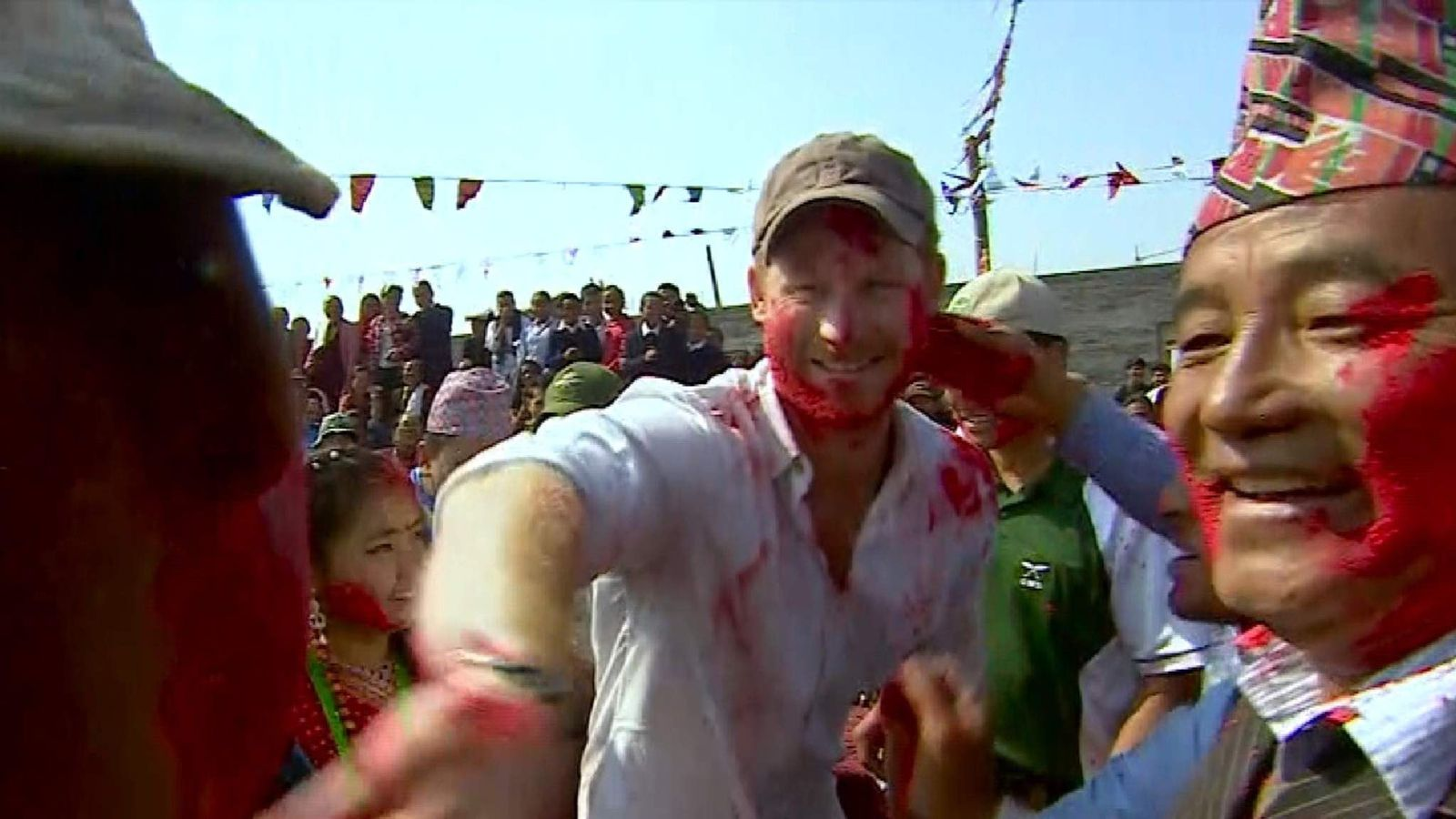 Harry gets covered in paint in Nepal