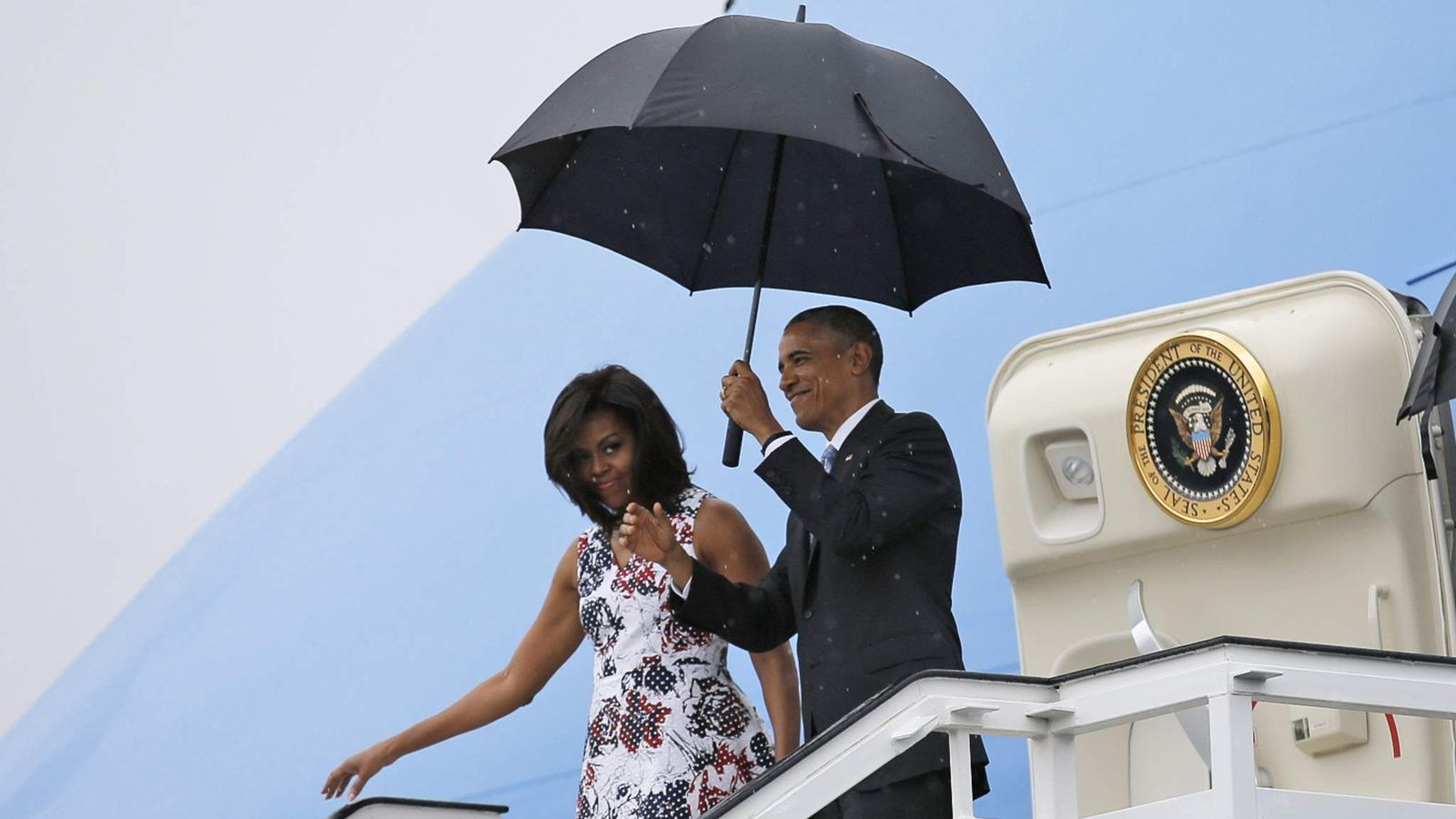 U.S. President Barack Obama and his wife Michelle exit Air Force One at Havana's airport