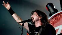 Musician Dave Grohl of the Foo Fighters performs at the Forum on September 22, 2015 in Inglewood, California.