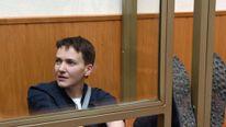 Ukrainian military pilot Nadiya Savchenko sits inside a defendant's cage