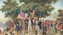 A print from a painting showing Captain James Cook (1728 - 1779) taking possession of New South Wales