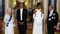 U.S. President Obama and first lady Michelle Obama pose before dinner hosted by Queen Elizabeth in London