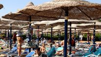 Tourists sunbathe on the sea side at the Red Sea resort of Sharm el Sheikh