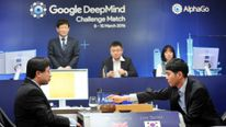 Lee Sedol (R), puts the first stone against Google's artificial intelligence program AlphaGo.