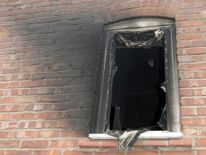 Undated handout photo issued by Greater Manchester Police of the upstairs window of a house where a 49-year-old woman was doused with petrol before she was set alight.