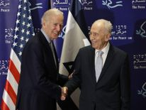 US Vice President Joe Biden (L) shakes hands with former Israeli president Shimon Peres