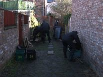 Police searching alleyway at the back of Claudia Lawrence's home