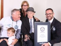World's oldest man Israel Kristal with Marco Frigatti of Guinness World Records, son Heim Kristal, daughter Shula Kuperstoch and great grandchildren