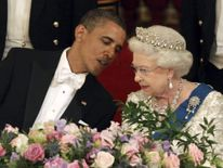 U.S. President Barack Obama speaks to Britain's Queen Elizabeth during a State Banquet in Buckingham Palace in London