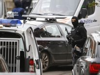 File photo of Belgian police being seen outside of a house during a search of suspected muslim fundamentalists linked to the deadly attacks in Paris, in the Brussels suburb of Molenbeek