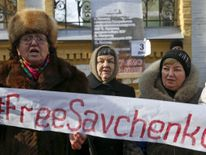 Maria Savchenko, mother of Ukrainian army pilot Nadezhda Savchenko, takes part in a rally demanding the liberation of her daughter, near the presidential administration headquarters in Kiev