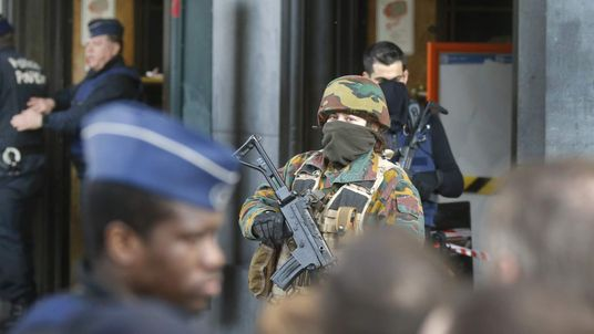 Police control the access to the central train station following bomb attacks in Brussels, Belgium