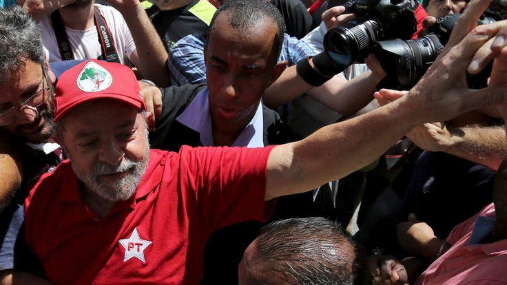 Former Brazilian President Luiz Inacio Lula da Silva is greeted by supporters in front of his home in Sao Bernardo do Camopo