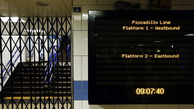 A departure board shows neither times nor information for tube trains on the Piccadilly Line during strikes at Green Park underground station in London