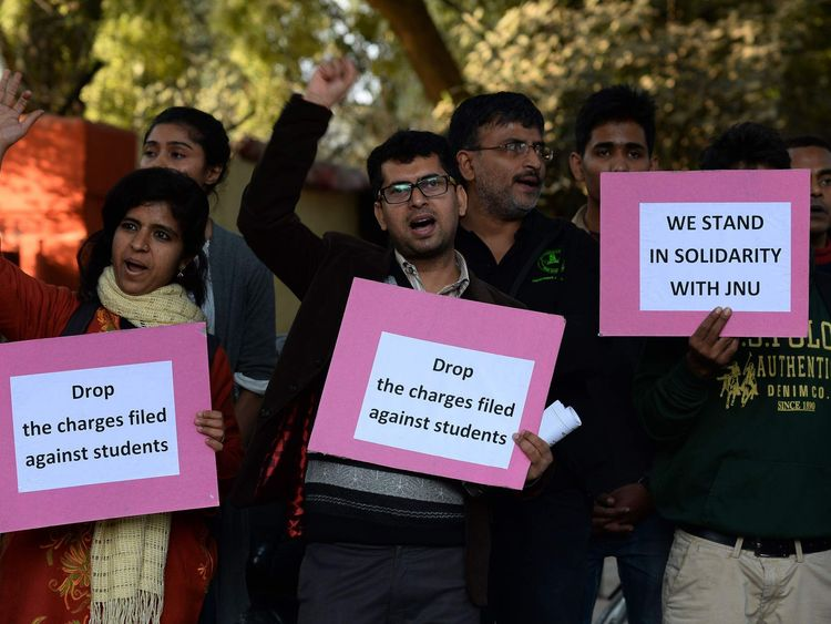 Indian students hold placards