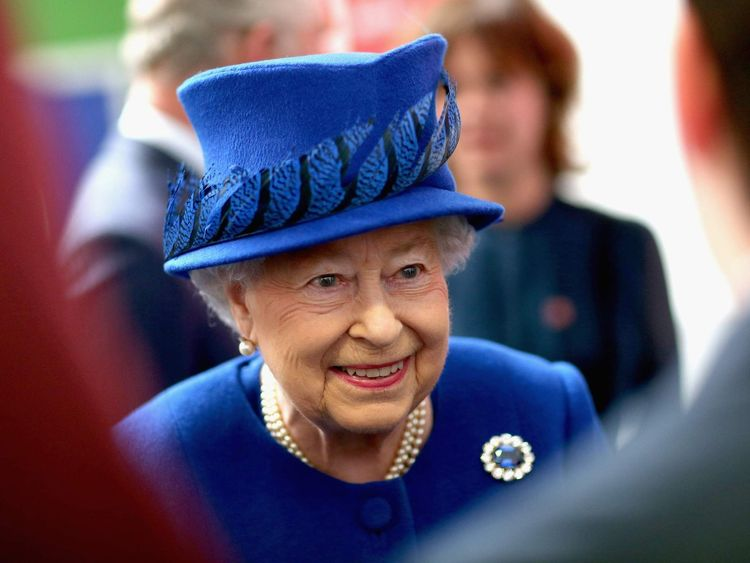 Queen Elizabeth II  smiles as she meets people being helped by the Prince's Trust