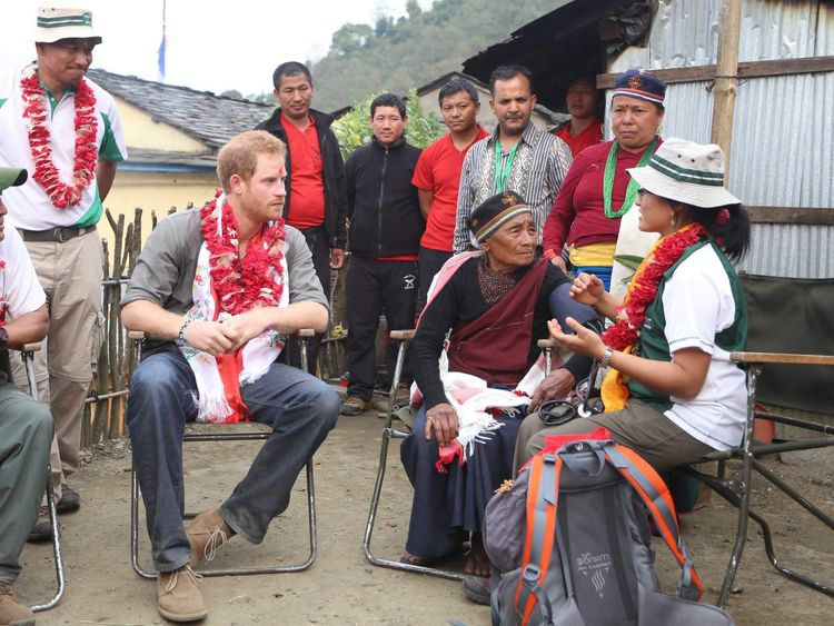 Prince Harry sits next to Mangali Tamang