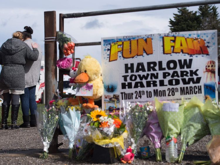 Floral tributes at the scene where a seven-year-old girl died after she was blown around 150 metres on a bouncy castle, which is thought to have been swept away by a sudden gust of wind.
