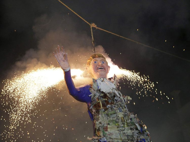 Mexicans burn an effigy of U.S. Republican presidential hopeful Donald Trump as they celebrate an Easter ritual late on Saturday in Mexico City's poor La Merced neighborhood