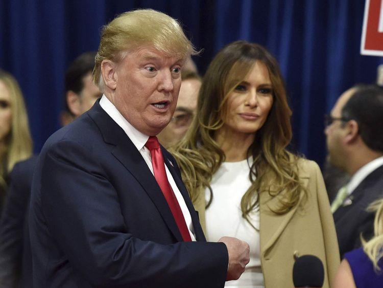 U.S. Republican presidential candidate Donald Trump and his wife, Melania Trump, speak to the media in the spin room following the U.S. Republican presidential debate in Las Vegas
