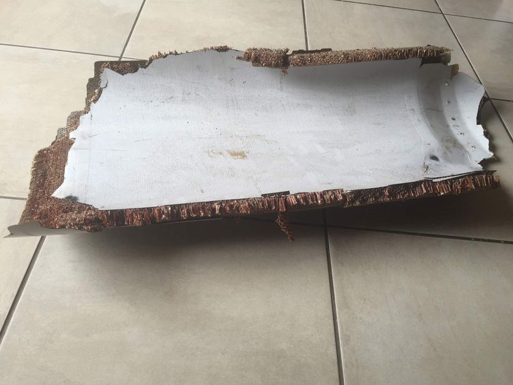 Handout photo of piece of debris found by a South African family off the Mozambique coast, which authorities will examine to see if it is from missing Malaysia Airlines flight MH370