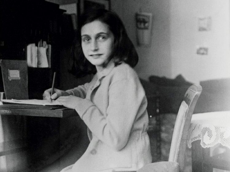 Hand out picture of Anne Frank at her desk in her house at the Merwedeplein in Amsterdam