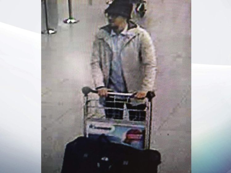 The suspect still at large was wearing a hat and a light-coloured jacket